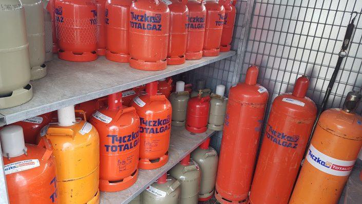 Gashandel, Gasflaschen, graue Gasflasche, Alimuniumgasflasche, rote Gasflasche